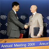 Zhang Xiaoqiang, Vice Chairman, National Development and Reform Commission, China; Klaus Schwab, Founder and Executive Chairman, World Economic Forum