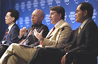 Left to right: Kim Hyun-Chong, Minister of Trade of Republic of Korea; Klaus Schwab, World Economic Forum; Peter Mandelson, Commissioner, Trade, European Commission, Brussels; Lim Hng-Kiang, Minister for Trade and Industry, Singapore
