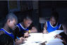 Photo: Young boys studying