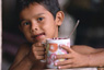 Photo: Young boy drinking cocoa